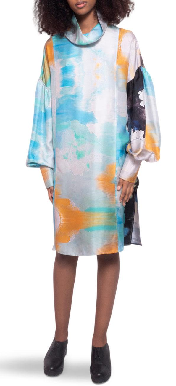 model wearing short silk dress in arty print